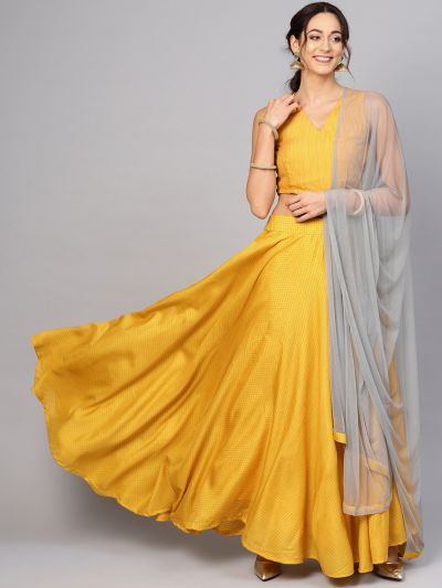Yellow self designed Lehenga with Choli with net dupatta