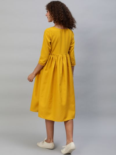 Yellow Solid Pleated Dress With Red Thread Yoke Details